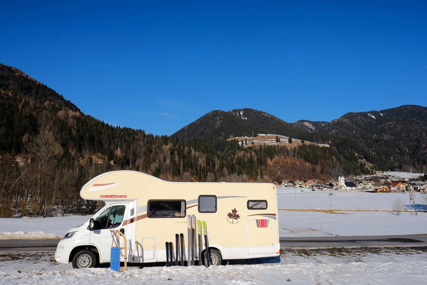 Camping in the winter season by the ski slope.